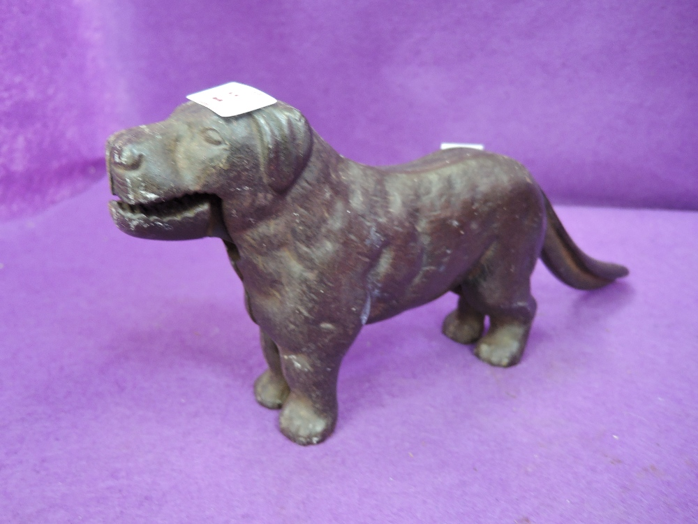Lot 22 - A vintage cast iron nut cracker in the form of a dog