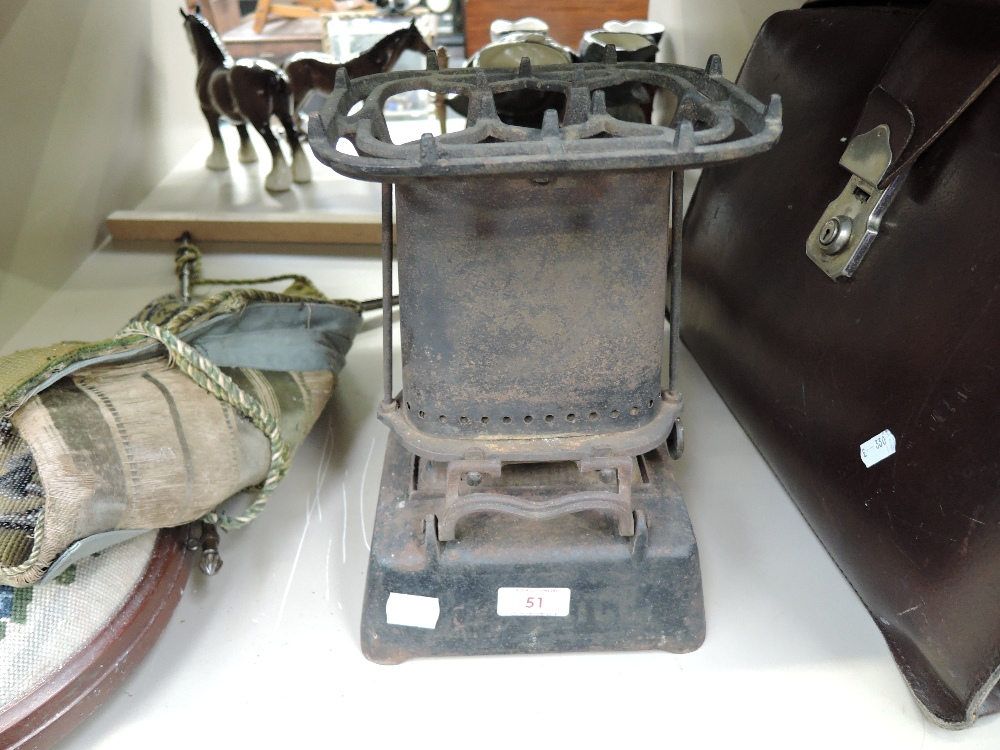 Lot 51 - A vintage cast iron portable travel stove marked Beatreol to base