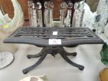 Lot 18 - A vintage cast iron fire trivet