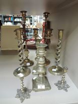 Lot 13 - A selection of vintage brass candle sticks including twist stem, floral base and 4 tier
