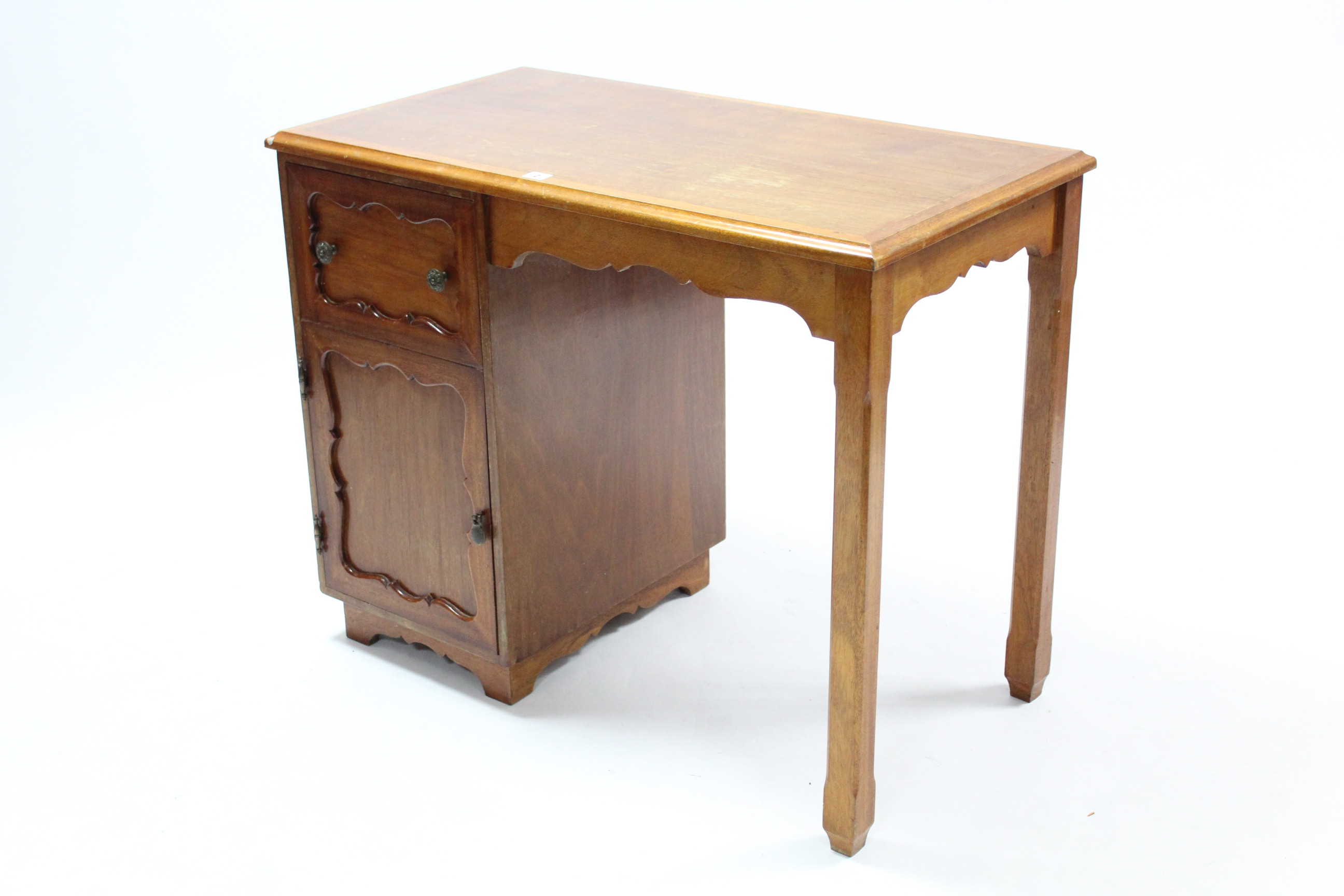 Lot 2 - A mahogany kneehole desk, the left-hand side fitted frieze drawer above cupboard enclosed by panel