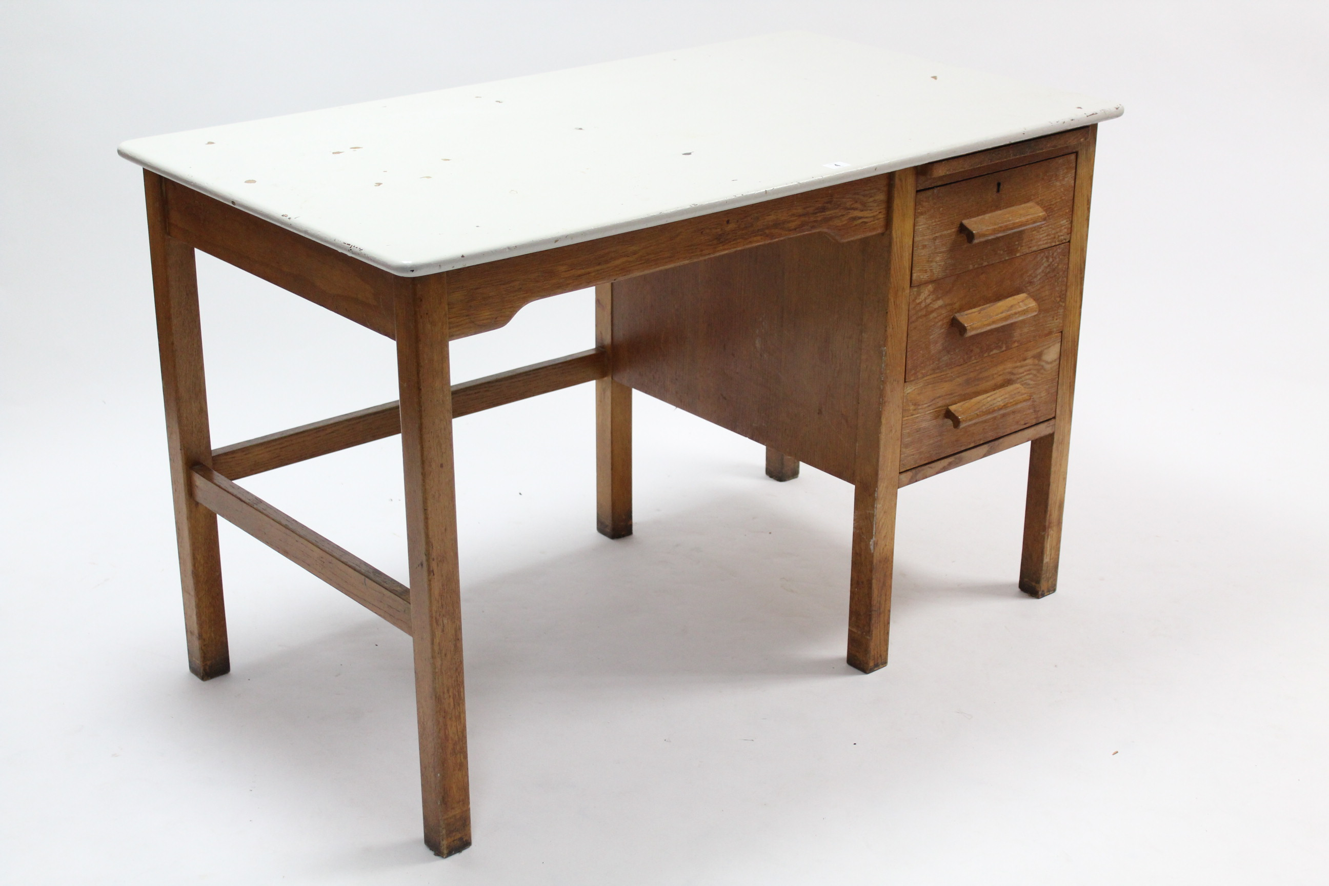 Lot 4 - A white painted & natural oak knee-hole office desk the right-hand side fitted brushing slide