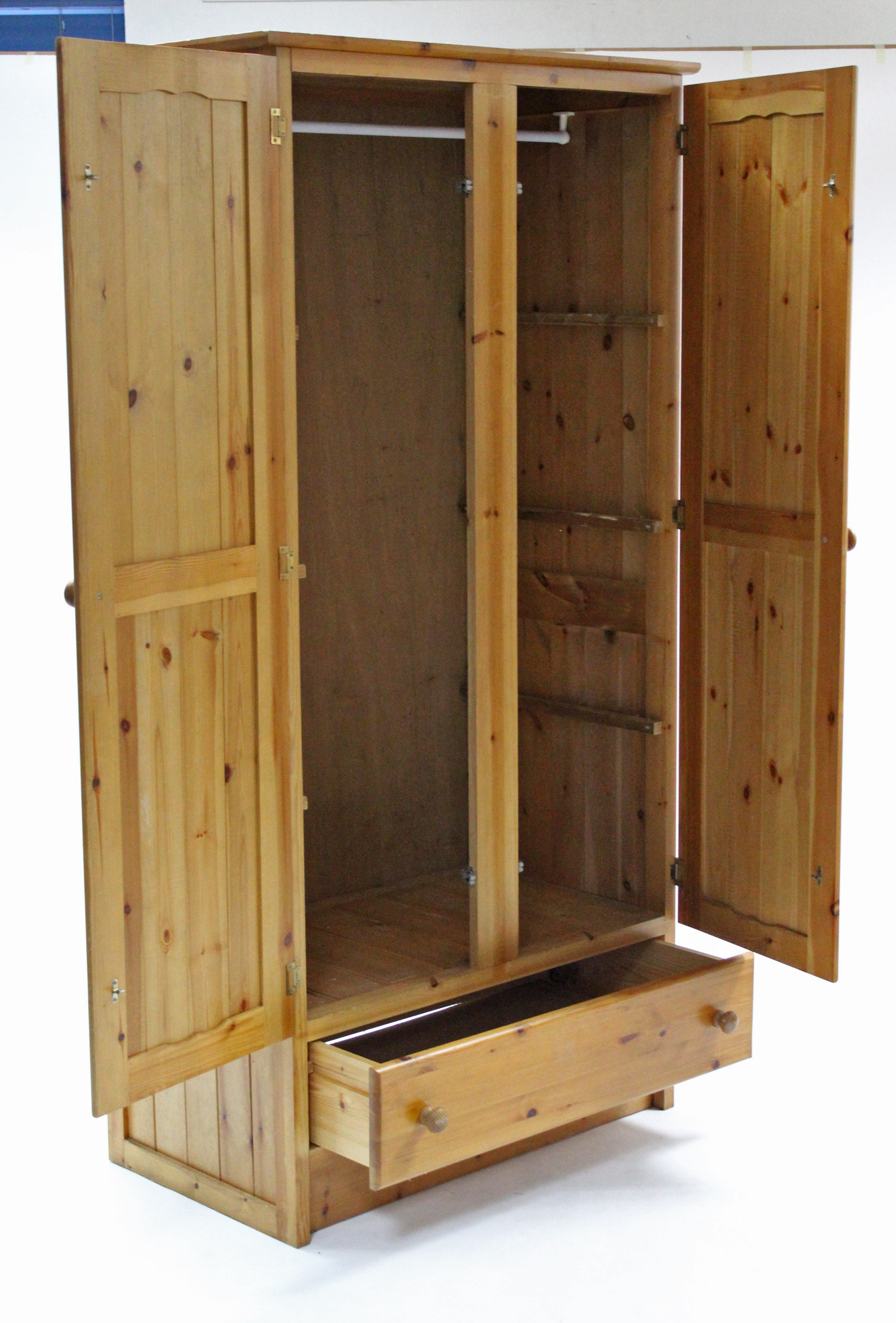 "Lot 17 - A pine wardrobe enclosed by pair of panel doors above a long drawer, 37"" wide x 73"" high."