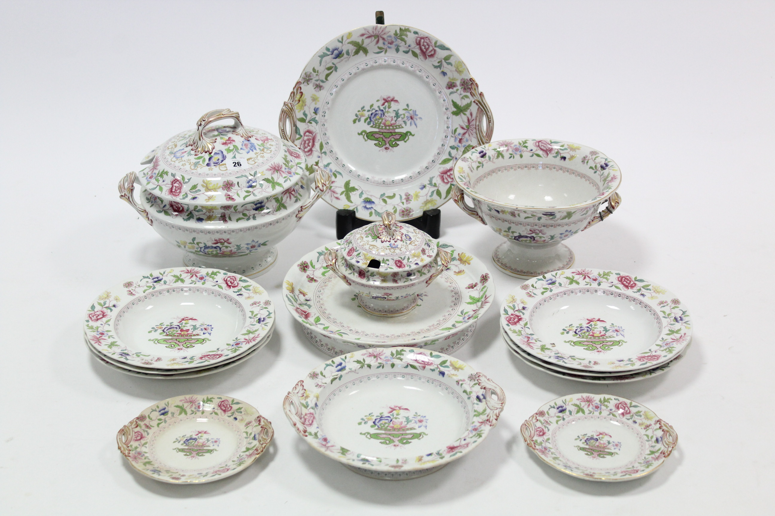 Lot 26 - A Victorian china floral decorated thirteen-piece part dinner service including a circular tureen,