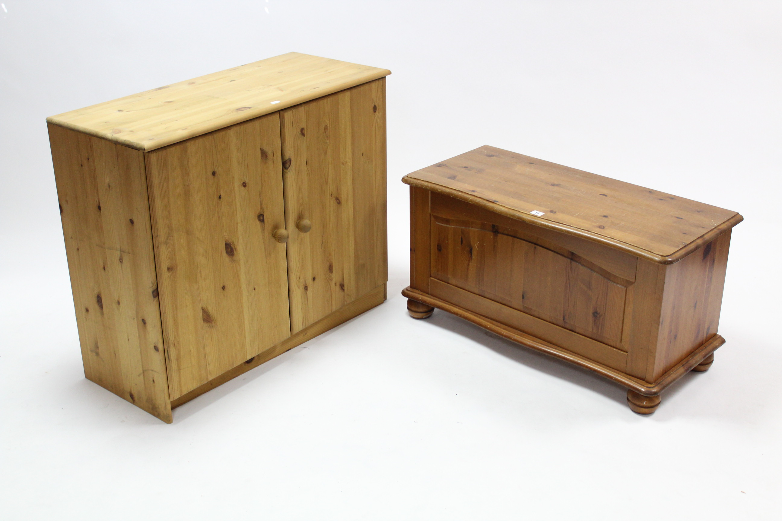 """Lot 11 - A pine serpentine-front blanket box with hinged lift-lid; & on bun feet, 33½"""" wide; & a pine dwarf"""