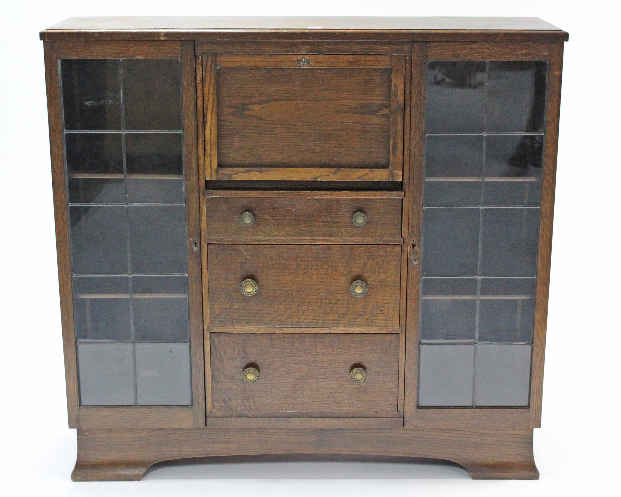 Lot 36 - A mid-20th century oak side cabinet, with fitted interior to centre enclosed by fall-front above