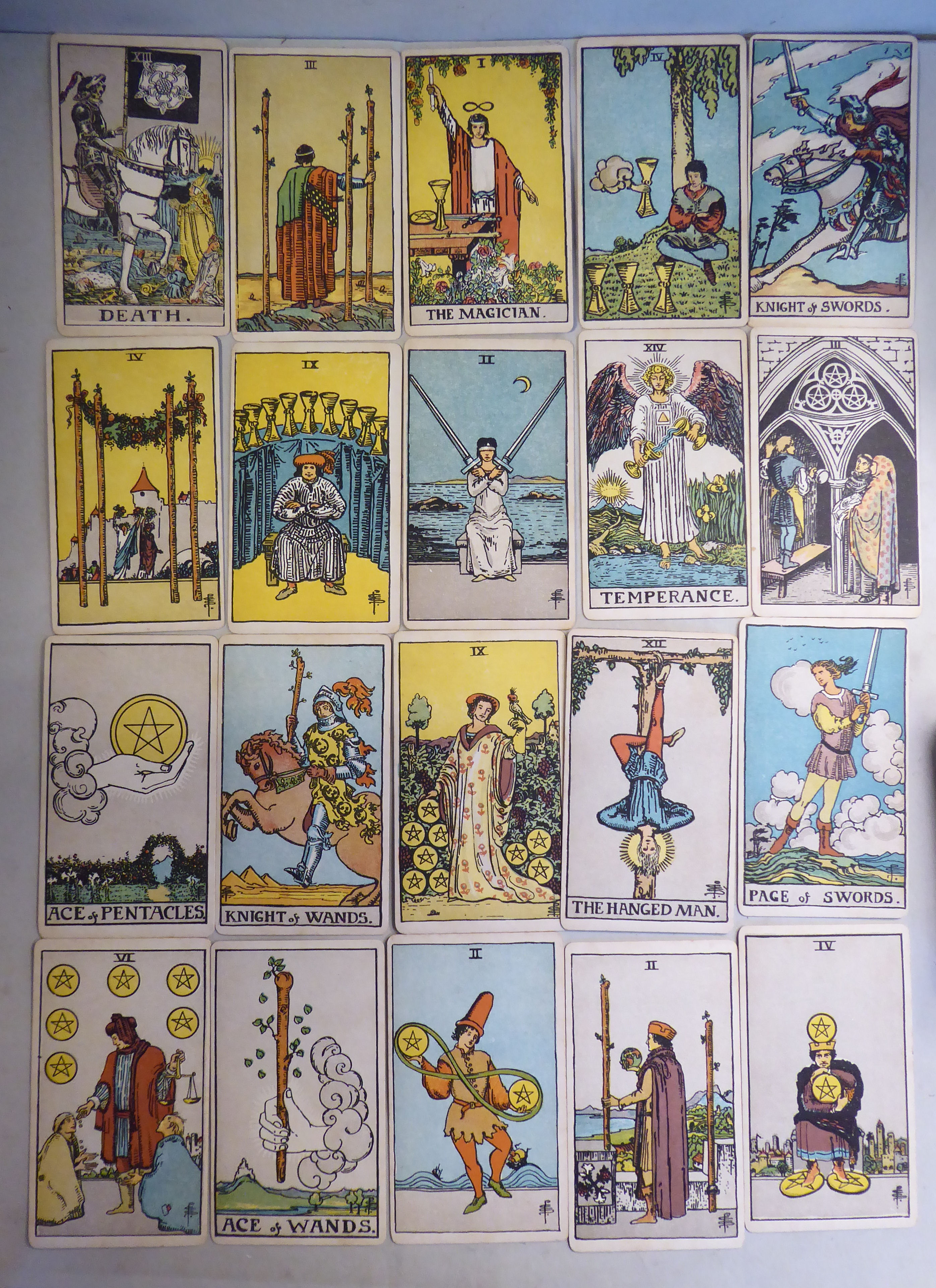 Lot 75 - Tarot cards - a 1909 First Edition of the Rider Waite 'Roses & Lillies' Tarot deck,