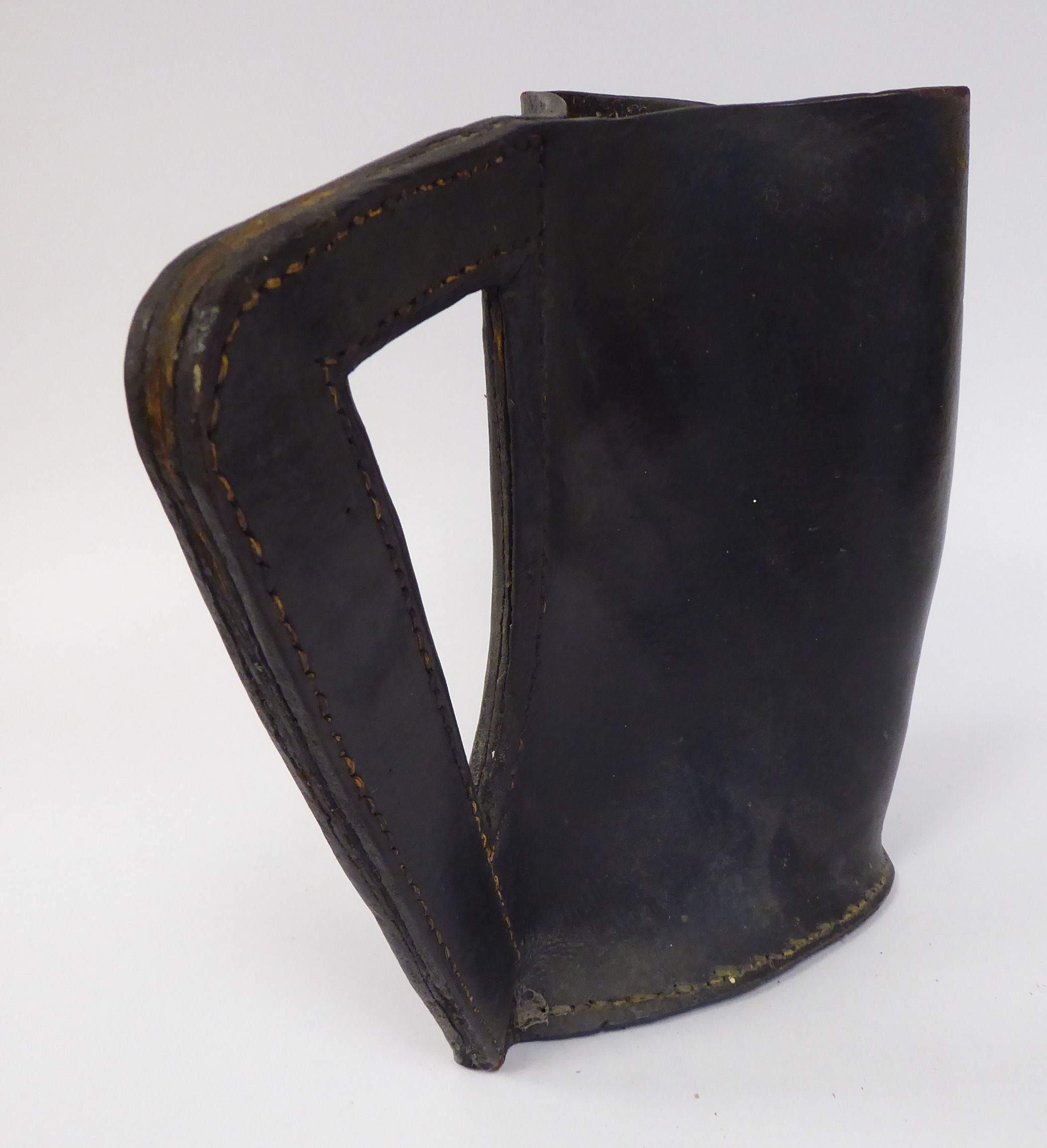 Lot 35 - An 'antique' Black Jack moulded and stitched hide jug with an angular handle 10''h