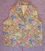 Lot 33 - A mid 19thC silk lined gilet/waistcoat with a rolled collar and finely embroidered,