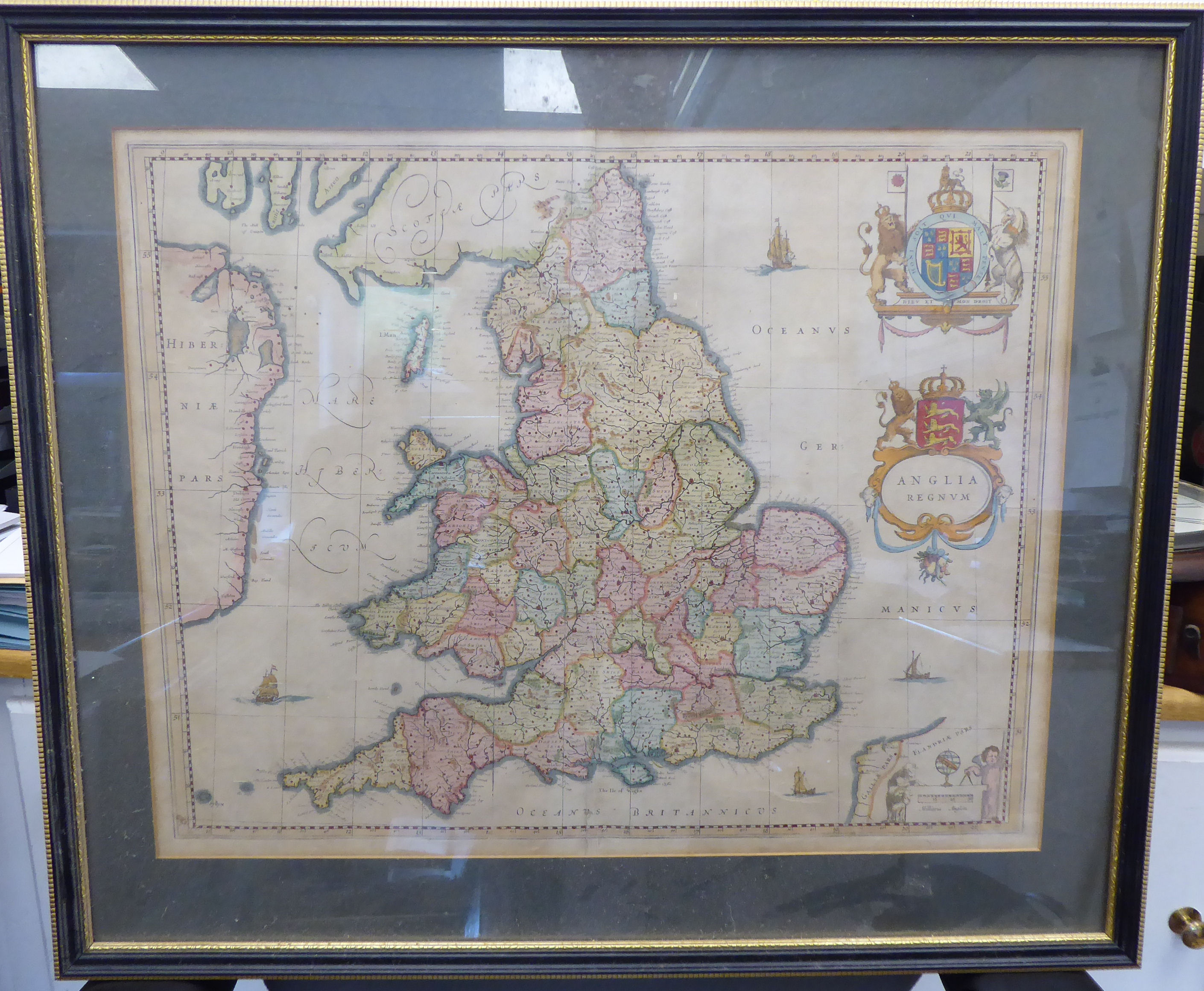 Lot 39 - A mid 17thC J Blaeu coloured map 'Anglia Regnvm' incorporating a scrolled title cartouche and arms