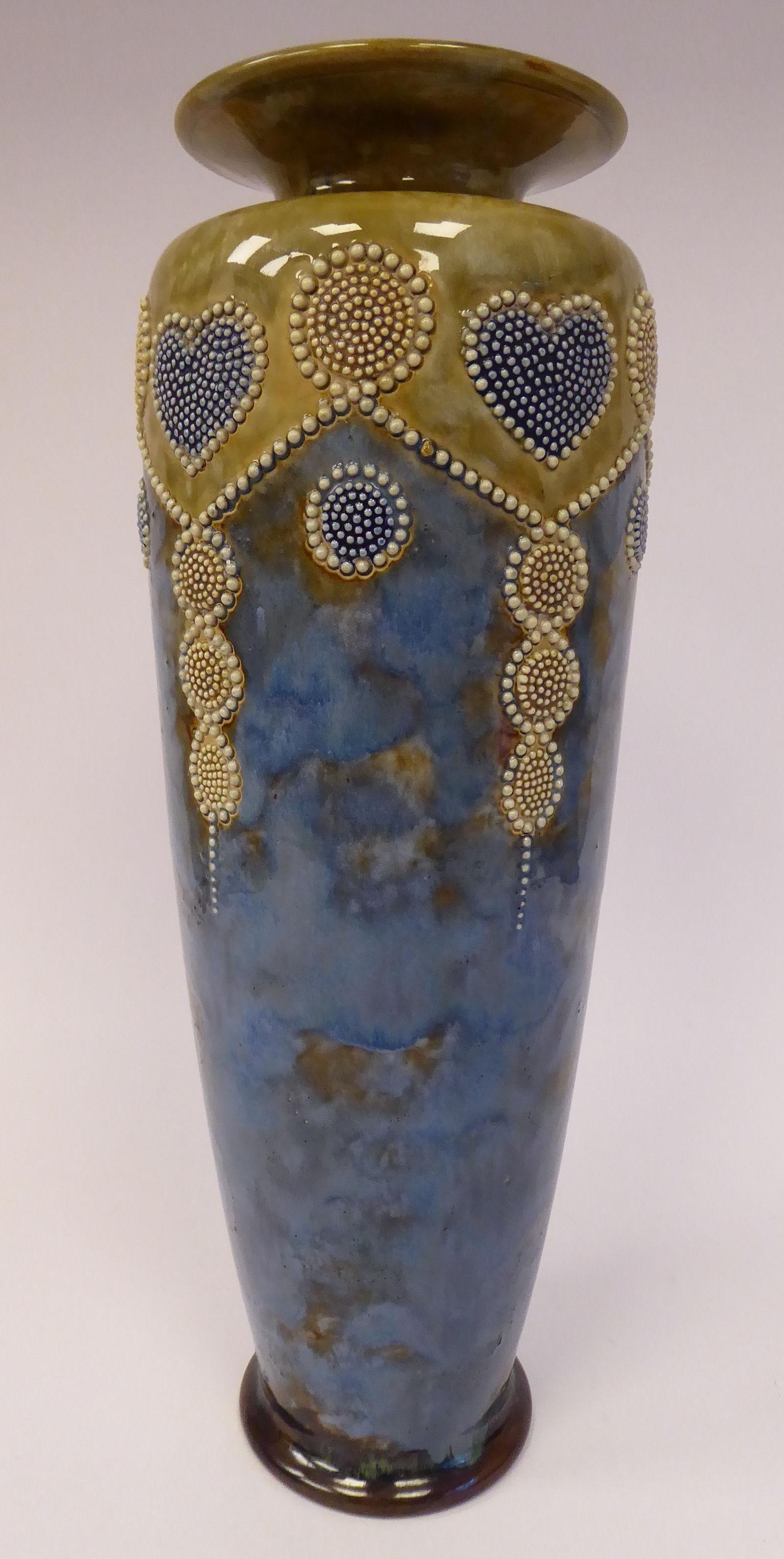 Lot 2 - An early 20thC Royal Doulton sponged blue, green and white glazed stoneware vase of slender,