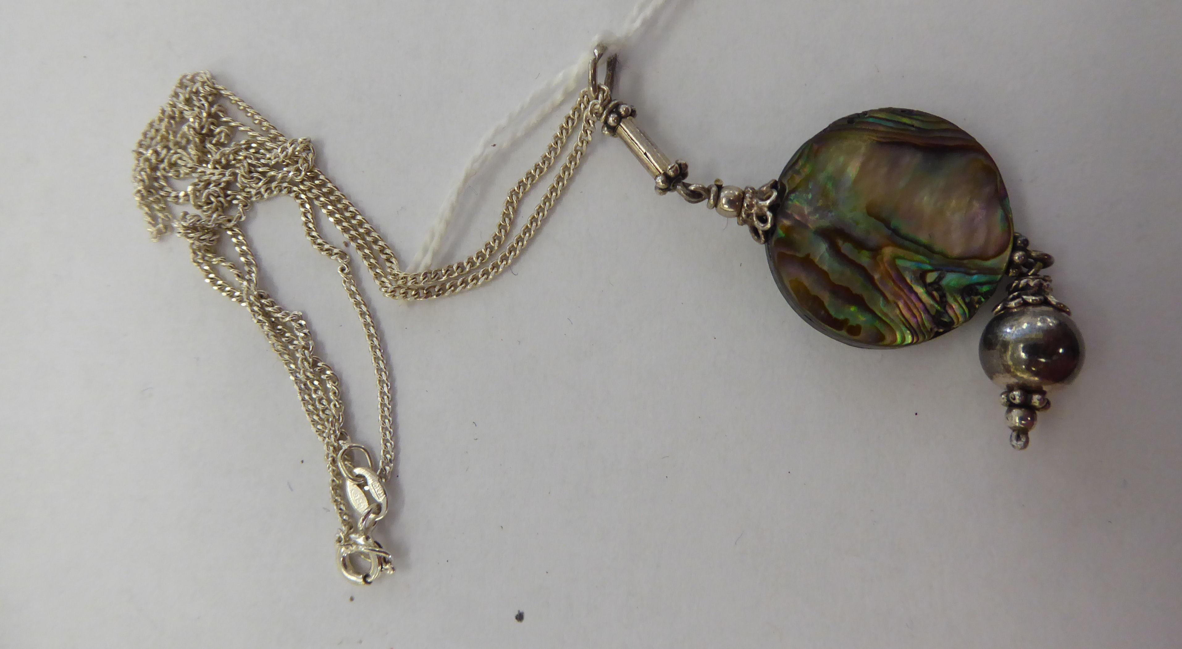 Lot 3 - A silver abalone pendant necklace 11