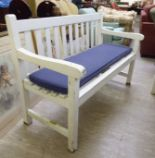 Lot 52 - A modern white painted garden bench of slatted construction,