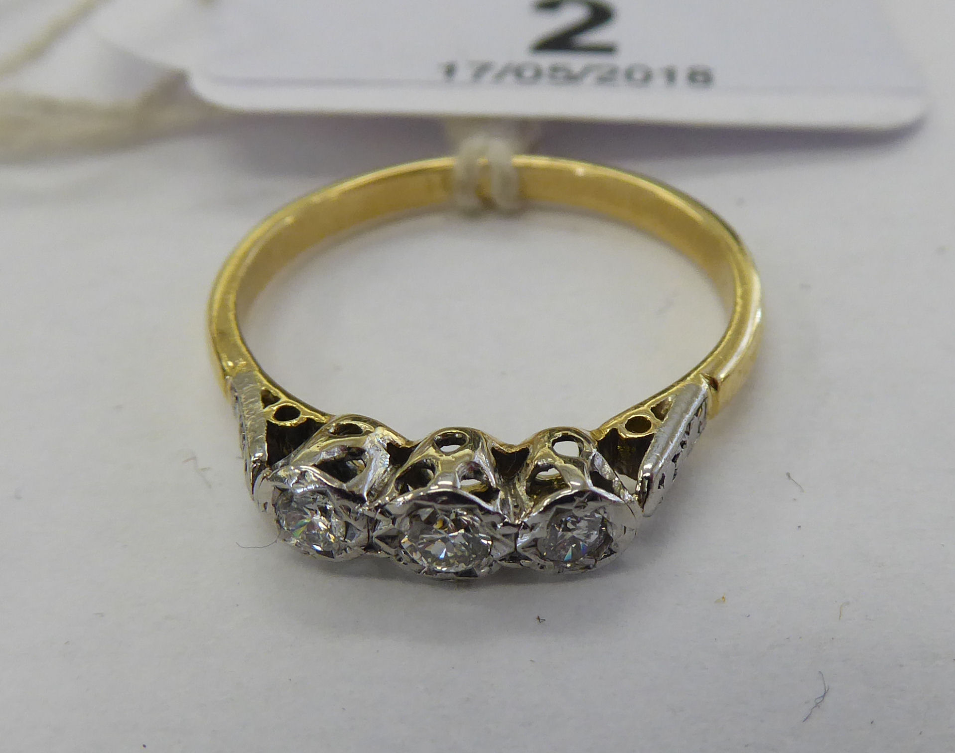 Lot 2 - An 18ct gold three stone diamond ring 11