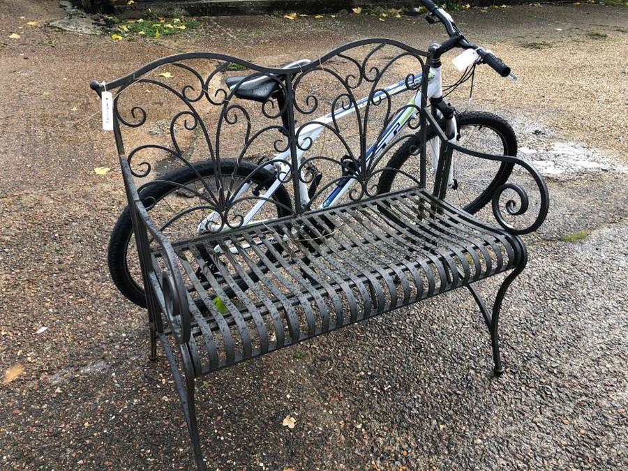 Lot 17 - A steel garden bench