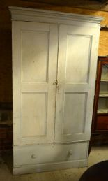 Lot 35 - Large antique painted pine cupboard with twin panelled doors enclosing shelves, over a single drawer