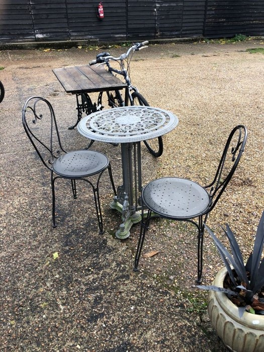 Lot 19 - A Victorian style cast iron garden/terrace table to/with a pair of chairs (3)