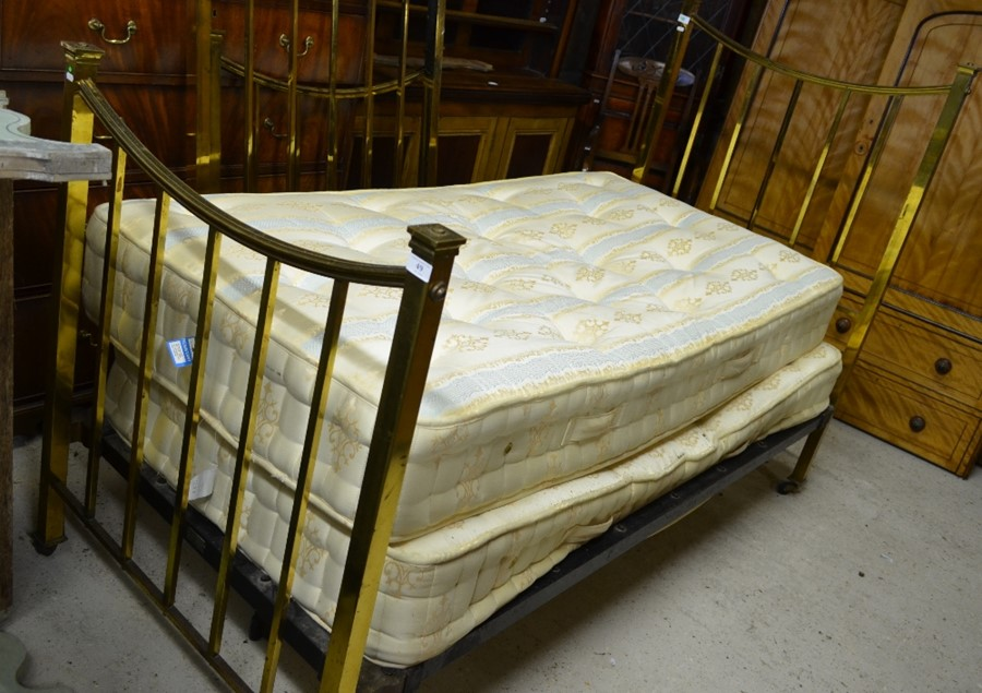 Lot 49 - A pair of late 19th/20th century single brass bedsteads to/w pocket sprung mattresses (2)