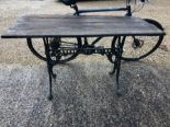 Lot 18 - A cast iron Colebrookdale style plank top garden table
