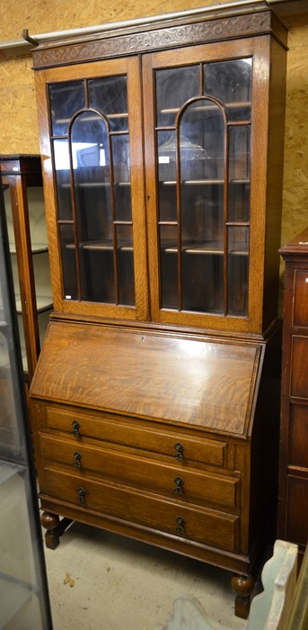Lot 38 - Oak bureau bookcase with a pair of glazed doors and fall front panel with fitted interior over three