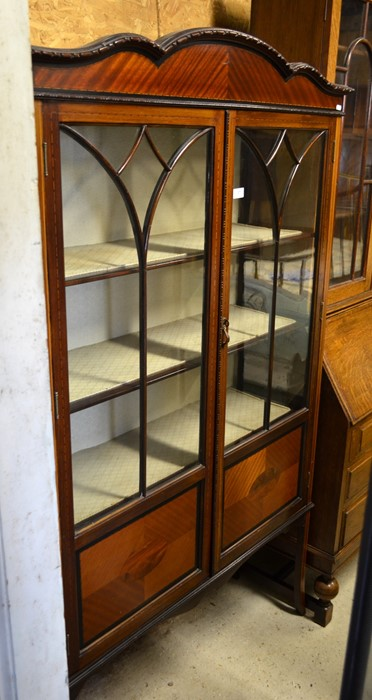Lot 37 - Edwardian inlaid mahogany display cabinet with glazed and panelled doors enclosing three shelves