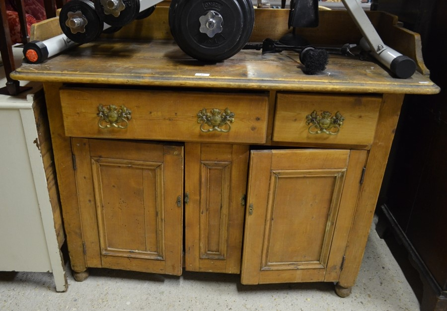 Lot 46 - An old pine sideboard with galleried back over two drawers and panelled cupboard doors