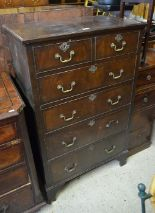 Lot 59 - Georgian style tallboy chest of two short over four long drawers raised on bracket feet