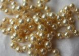 Lot 108 - A pair of cultured pearl necklaces, with regular pearls each approximately 8mm diameter,