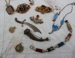 Lot 25A - A Scottish hardstone set brooch together with a silver sword bookmark,