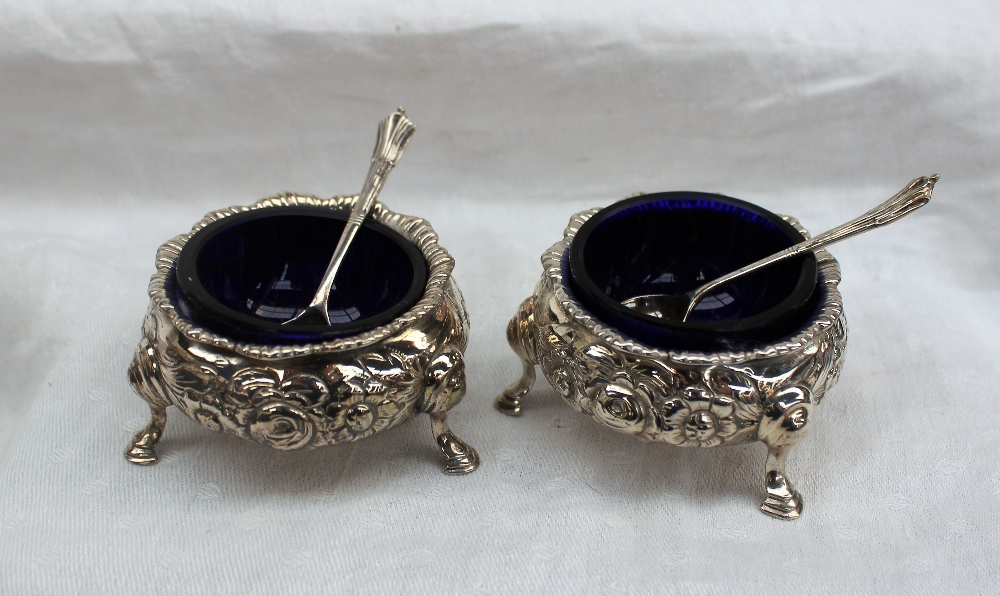Lot 368 - A pair of Victorian silver cauldron shaped salts embossed with roses and leaves on hoof feet, 1847,