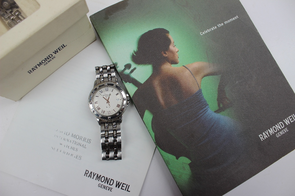 Lot 24 - A Raymond Weil mid size Tango wristwatch the white and silvered dial with Roman numerals and date