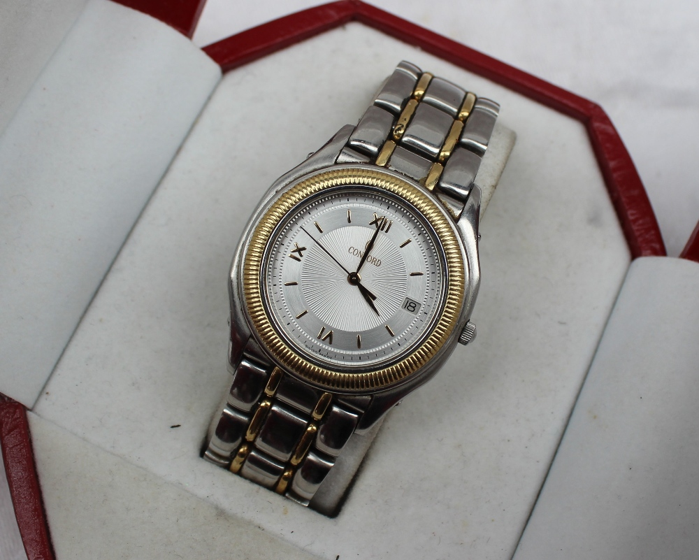 Lot 25 - A Concord mid size wristwatch the silvered dial with Roman numerals and batons with date aperture