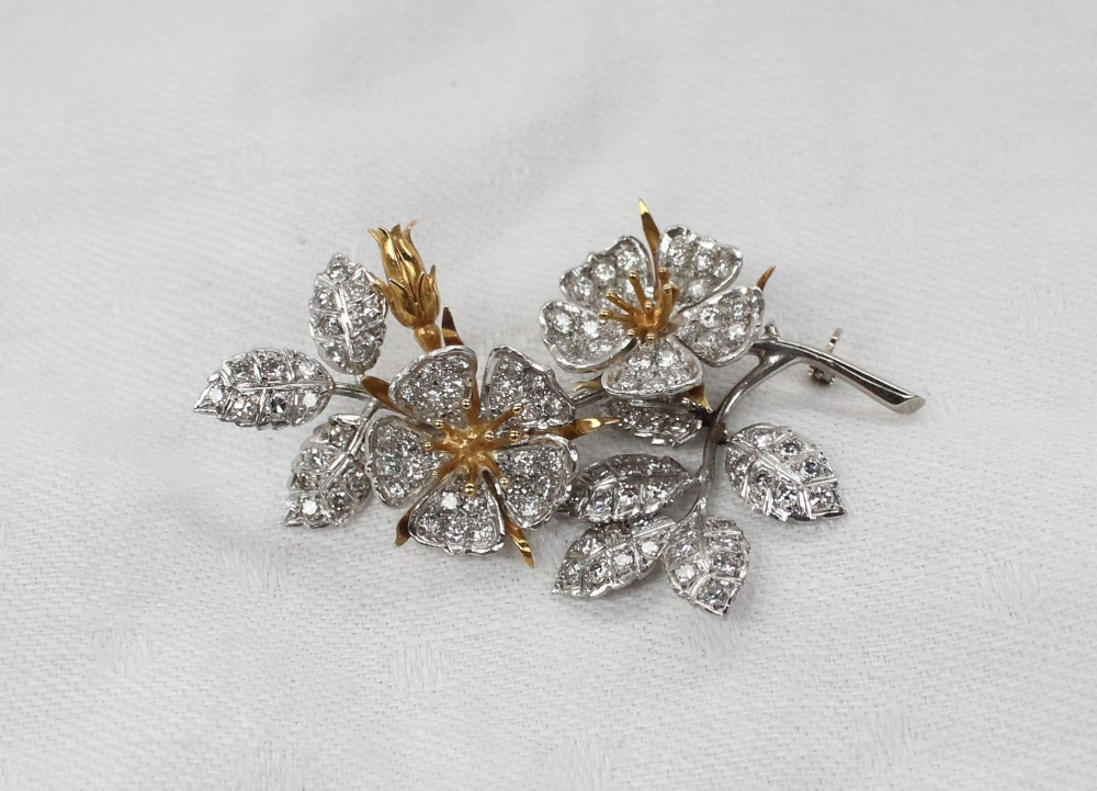 Lot 5 - An 18ct yellow and white gold brooch in the form of flower heads,