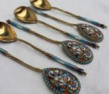 Lot 367 - A set of six Russian cloisonne enamel and gilt decorated spoons,