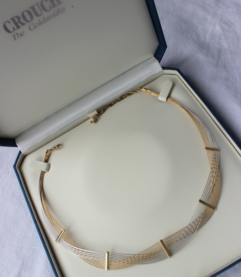 Lot 48 - A 9ct yellow and white gold wirework necklace,