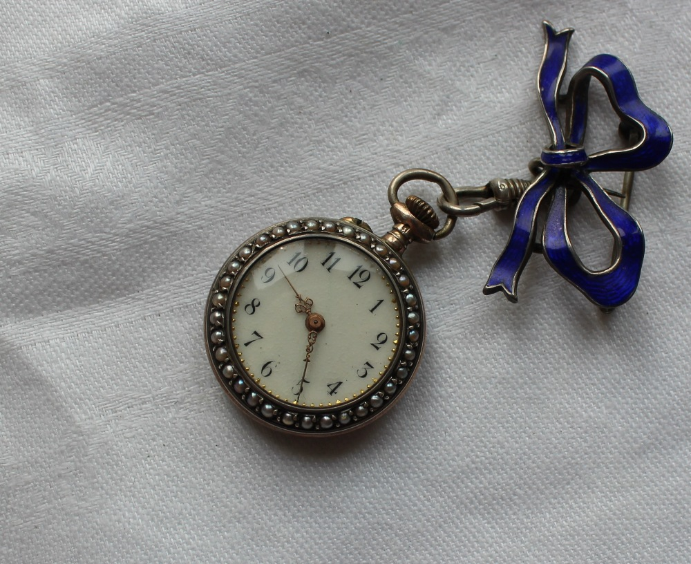 Lot 107 - A French white metal, enamel and seed pearl decorated fob watch,