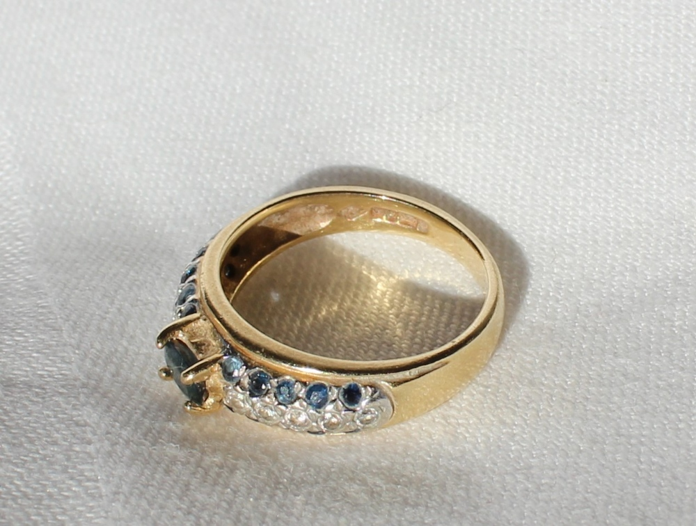 Lot 70 - A sapphire and diamond ring,