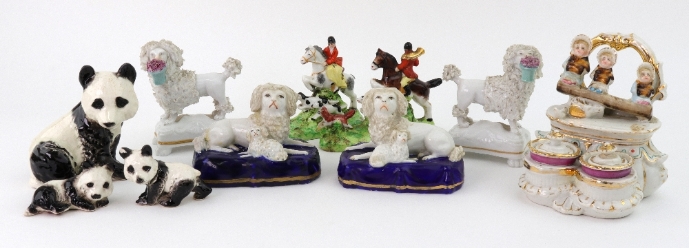 Lot 7 - A pair of French porcelain figures of seated King Charles Spaniels, 9cm wide,