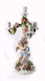 Lot 61 - A Sitzendorf porcelain three light candelabrum encrusted with roses, having scrolling branches,