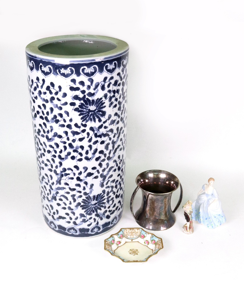 Lot 25 - A modern Chinese porcelain blue and white umbrella spill, 46cm high, a small Noritake dish,