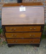 Lot 705 - A late 19th century mahogany bureau with fitted interior over three drawers and with shell inlay