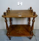 Lot 703 - A small Victorian walnut inlaid two tier side table with turned supports and finial's,