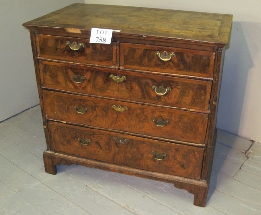Lot 758 - A fine 18th century figured walnut chest of two short over three long drawers with brass handles