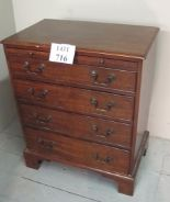 Lot 716 - A 19th century mahogany bachelor's chest of small proportions with pull out brushing slide over