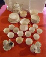 Lot 6 - A QUANTITY OF TEA WARE, white, some with gilt decoration and gilt handles, together with two