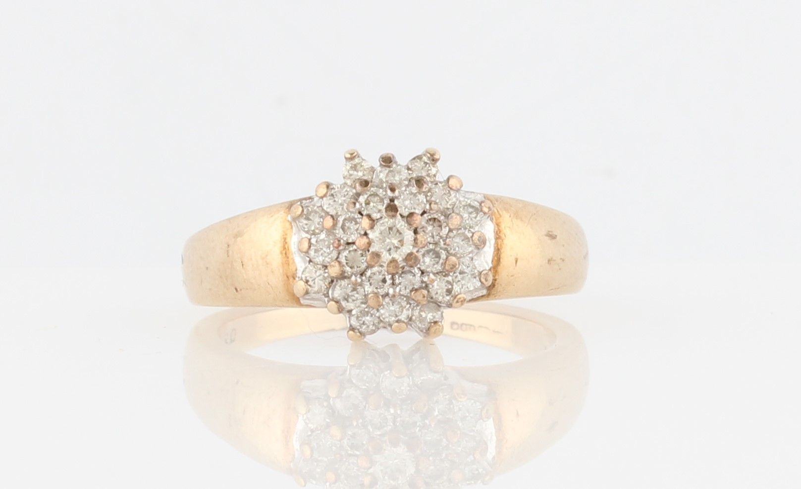 Lot 47 - A 9ct yellow gold tiered diamond cluster ring, set with four tiers of round brilliant cut