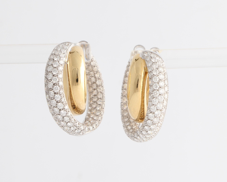 Lot 11 - A pair of diamond set hoop stud earrings, each earring designed as two crossing hoops, the inner