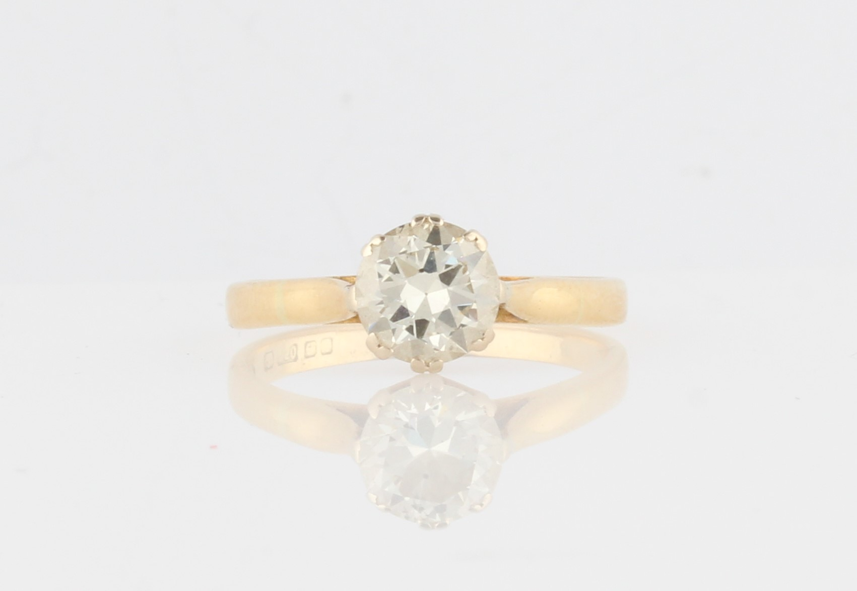 Lot 19 - An 18ct yellow gold diamond solitaire ring, set with a round brilliant cut diamond measuring approx.