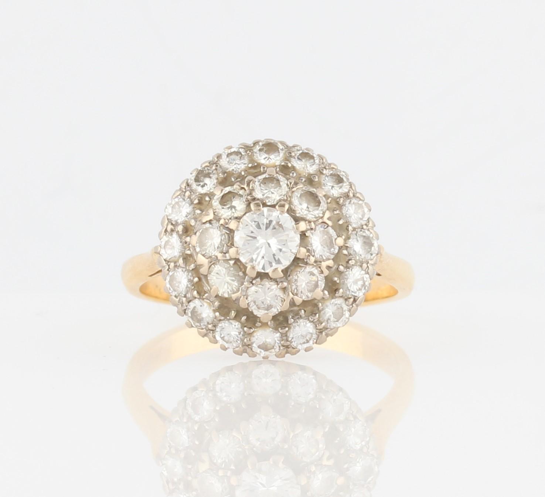 Lot 23 - A three tier diamond cluster ring, set with three graduated tiers of round brilliant cut diamonds,