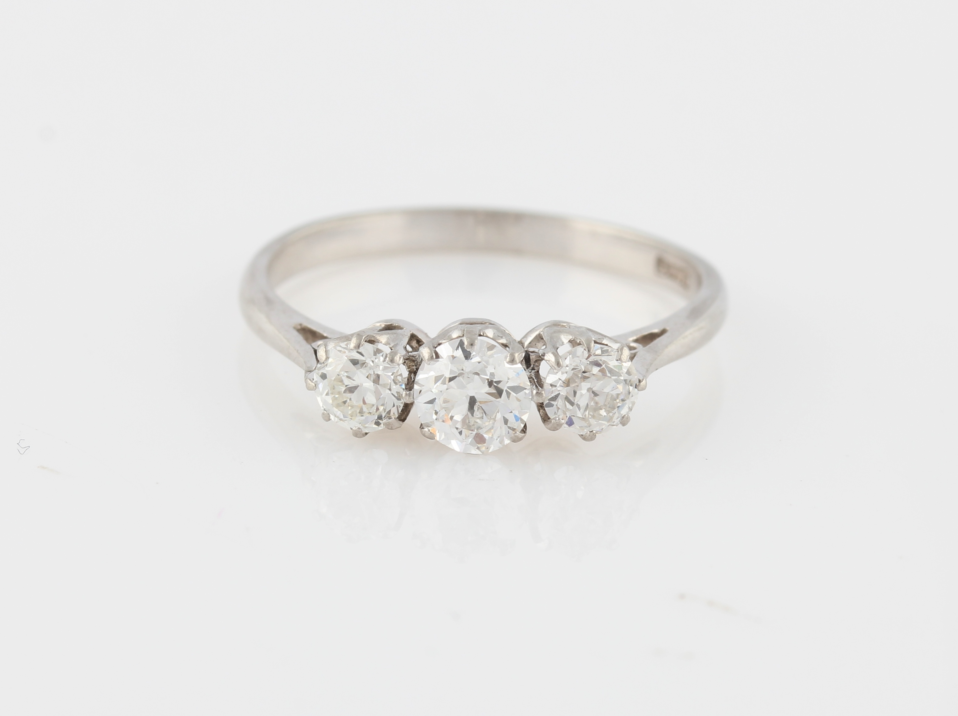 Lot 9 - A three stone diamond ring, set with three graduated old cut diamonds, total diamond weight